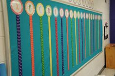 word wall....love the ribbon and could easily clip the words to them as the year goes on!