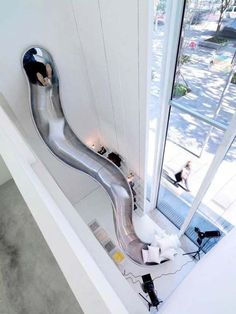 indoor slides are pretty common now, [who the hell is posting this. i dont know anyone with indoor slides.] but I love that this one almost sends you out the window. Fun idea for leading from a childs bedroom, to downstairs playroom, to outdoor play. Indoor Slides, Modern Stairs, House Goals, Life Goals, Dream Rooms, Dream Bedroom, Cool Rooms, Design Case, Home Design