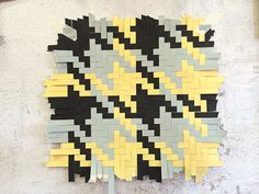 Pied-de-poule pattern woven out of paper by textile designers Helle Gråbæk and Maria Kirk Mikkelsen. Originally a traditional ancient Hawaiian pattern, I love it in these colours.