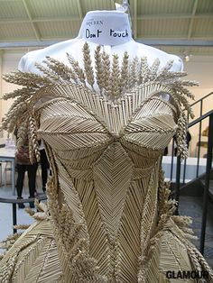 Sarah Burton's woven bustier gown (rumor has it that the stunning creation was co-crafted by a corn husk guild based in the U.K.) for Alexan...