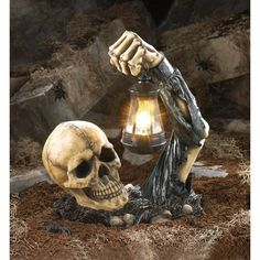 This creepy skeleton looks like it's coming right out of the ground! A fantastic welcoming Halloween decoration. Swinging lantern lights up with two AA batteries, not included. Weight 3.8 pounds 11 x 6.5 x 13 inches tall Polyresin and plastic