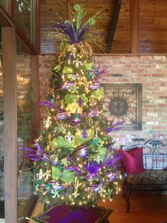 My Mardi Gras Tree! If you haven't taken your christmas tree down by mardi gras you might as well do something with it!