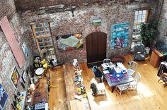 space exposed brick wood floors