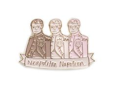Make sure every outfit is victorious with this enamel lapel pin featuring my original Neapolitan Napoleon drawing, with Napoleon Bonaparte illustrated in chocol