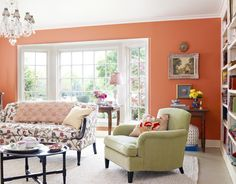 The living room's Federal-style sofa is re-covered in crewelwork fabric, the armchair in cotton suede.