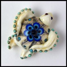 Lampwork turtle bead I made. My work is available on my website www.beadworx.com