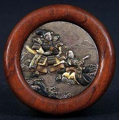 Shakudo Button in a wood frame