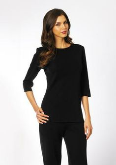 Understated and classic, this style will coordinate with your favorite looks. A wardrobe basic with jewel neck and ¾ sleeves, it is a bit longer in length to drape gracefully to low hip length. Designed to skim the body, it is both comfortable and flattering. Perfect for all season wear, it moves from casual to work appropriate and travels well. Acrylic/polyester blend. Unlined. Imported. Machine or hand wash. Do not iron. Misses  XS(2), S(4-6), M(8-10), L(12-14), XL(16).