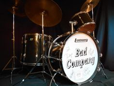 Simon Kirke, Bad CompanyLudwig 26×14,14×10, 20×18 black lacquer over 3 ply wooden shells. Mach style lugs. Owned and used by Simon Kirke on Bad Company performances and recordings during the 1970s. Acquired from an English collector who purchased it directly from Kirke. Snare, cymbals and hardwar...