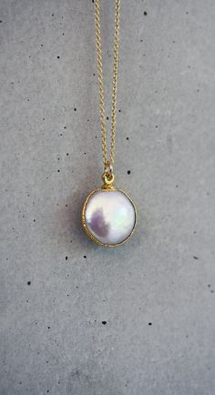Freshwater Coin White Pearl Bezel 14k Gold Filled Necklace. $42.00, via Etsy.