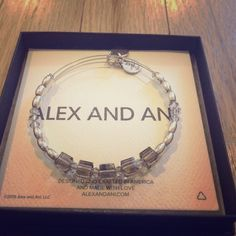 Flawless Alex and Ani Swarovski Crystal EWB Flawless Alex and Ani Swarovski Crystal and Shiny Silver EWB. Cubes are a beautiful smoked charcoal/gray. Alex and Ani Box, Pouch, and Care Card included. Price is firm. Stop by my closet for more great items to bundle!* Sorry...Trades. Alex & Ani Jewelry Bracelets