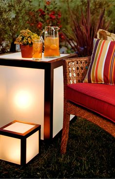 Brighten up your patio with cordless lights. The small cube is ideal for a tabletop and the larger one doubles as an end table.