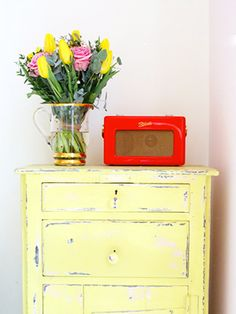 Add a splash of colour by painting an old piece of furniture two different colours, then sand heavily to expose the colour below.