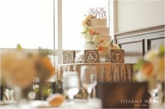 We're loving how sparkle meets rustic when it comes to the wedding cake table. Photo Credit - Tiffany Wayne Photography