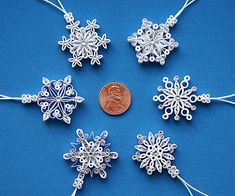 Six quilled / filigree miniature snowflakes, they make wonderful gifts, accent decorations or Christmas tree ornaments. The snowflakes are
