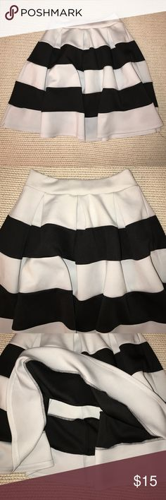 Charlotte Russe Silver & Black Striped Skirt S Minor signs of wear. Tag is falling off but can easily be fixed. In good condition. Silver and black skater skirt. High waist. Slips on. Unlined. Size S. 95% polyester & 5% spandex. Measured across: waist 12in & length 19in Charlotte Russe Skirts A-Line or Full