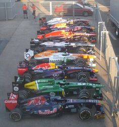 In honor of the upcoming Grand Pix Night Race in Singapore, here they are lined up, revving and waiting. What does a race car smell like? Sport F1, Sport Cars, Race Cars, Nico Rosberg, Formula 1, Grand Prix, Ferrari, Car Smell, Mc Laren