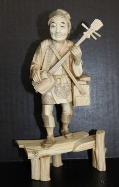 """19th C. Japanese Carved Ivory Figure. Measures - 9"""" high x 4 1/2"""" wide. Featuring a man playing an instrument."""