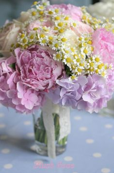 Pink pastel wedding bouquet - peonies, hydrangeas and chamomile daisies