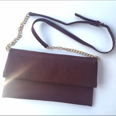 Burgundy Shouldbag/Clutch! Great condition! Great for dressing up or dressing down! Only one small own mark but you won't sent when the bag is closed. Multiple pockets and very stylish. Bags Shoulder Bags