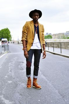 Try pairing a mustard blazer jacket with black jeans to achieve a dressy but not too dressy look. A pair of tobacco leather boots will seamlessly integrate within a variety of outfits.  Shop this look for $346:  http://lookastic.com/men/looks/hat-waistcoat-tank-blazer-jeans-watch-boots/6454  — Black Wool Hat  — Navy Waistcoat  — White Tank  — Mustard Blazer  — Black Jeans  — Gold Watch  — Tobacco Leather Boots
