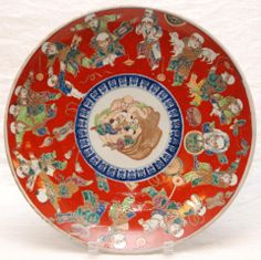 """Antique Japanese made hand painted porcelain Chinese style charger. Depicts Buddha with children to center. Numerous children over red ground to rim. Underside has blue scrolled vine design throughout. Bottom holds six character Ming Dynasty Chenghua reign mark. Made late Edo to Meiji period. Measures 2"""" height x 13 3/4"""" diameter (5.1cm x 34.9cm). Total weight of 1.28 kilograms. Provenance: Sam Feldman collection."""