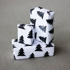 Wrap your gifts using plain white copy paper and homemade Christmas tree stamps.