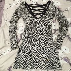 GUESS Long Sleeve Zebra Print Dress Sexy long sleeve mini for a night out on the town • Deep V front • Ribbon tie back • 80% Rayon, 20% Spandex Guess Dresses Mini