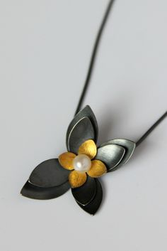 Succulent Pendant by Katie Carder. A lovely succulent inspired oxidized silver and 24 karat gold pendant with a lustrous freshwater pearl accent. Clay Jewelry, Jewelry Art, Silver Jewelry, Fine Jewelry, Jewelry Design, Mixed Metal Jewelry, Diy Jewelry Inspiration, Schmuck Design, American Jewelry