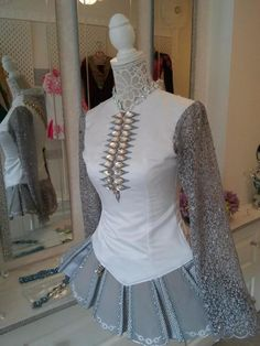 Gorgeous Irish Dance Solo dress. The dress is made out of grey and white fabric modern skirt makes the dress look majestic. Most of the beatiful crystals o