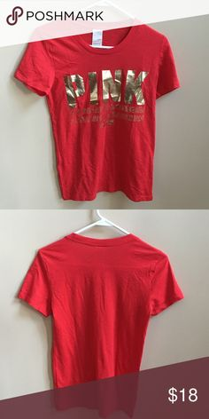 NWOT PINK Victoria Secret Logo T-shirt Medium PINK Victoria Secret Logo T-shirt Medium.  Red with metallic screen logo. New without tags's. Label marked to prevent store returns. Pet free smoke free posture. Bundle and save and only pay one shipping fee! PINK Victoria's Secret Tops Tees - Short Sleeve