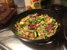 isn't this gorgeous?! taco meat stir fry with cabbage salad greens, bell peppers, & zucchini. c:
