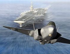 fighter jet taking off from an aircraft carrier.