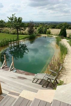 pool im garten Swimming Pool Ideas Beautiful. Want to turn your swimming pool area into a beautiful backyard getaway Find out how to easily create one. Swimming Pool Pond, Natural Swimming Ponds, Natural Pond, Swimming Pool Designs, Indoor Swimming, Natural Garden, Pond Design, Terrace Design, Small Pool Design