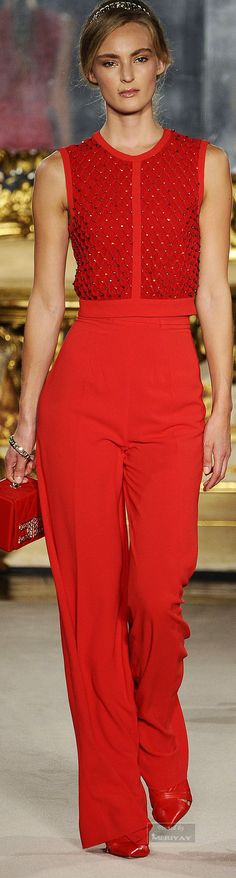 Elisabetta Franchi.Spring-summer 2015. Autumn red on an autumn.  Casual pants and texture in the top, perfect, lightly casual hair, she rocks it.