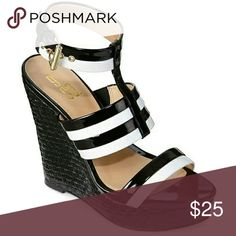 Labonita Ankle-Strap Wedge Sandals Black, white and hot all over, these ankle strapped sandals are sassy enough to start a commotion. Wear them with pride and confident, and heads will turn. Synthetic upper 5in wedge heel strapped styling with buckle ankle strap thermoplastic rubber sole. 9&Co Shoes