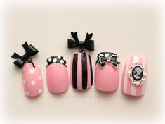 A perfectly sweet set of baby pink nails with girly detailing, including bow dangles, polka dots, and cameos. Perfect for photoshoots, gyaru