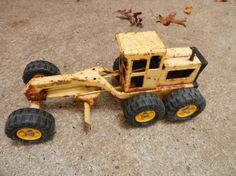 Metal Tonka toys in the sandbox.  Stepped backwards on a road grader just like this, big gash in the foot, out came the mercurochrome
