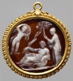 Glyptic Cameo: Ariadne between Eros and Aphrodite Roman, Early Empire First Century AD Onyx, white on brown. Frame: Gold hoop, 2 Half of the 16th Century.
