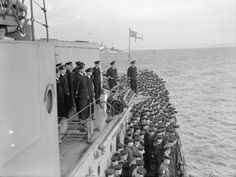 Rear Admiral Burnett and Captain Parham on 'X' gun deck of HMS Belfast watching the return of the USS Ranger from Operation Leader, an attack on German shipping in Norwegian fiords around Bodo.