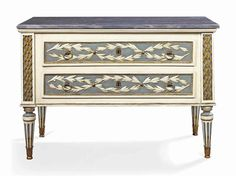 A NORTH ITALIAN CREAM AND BLUE-PAINTED COMMODE PIEDMONT, LATE 18TH CENTURY The rectangular moulded bardiglio marble top above two drawers, each decorated with entwined laurel swags, with trellis-carved supports, the sides centred with fruit baskets, on turned tapering and stop-fluted legs terminating in leaf-wrapped feet, the marble later, redecorated, the metalwork later 34¾ in. (88 cm.) high; 51 in. (129.5cm.) wide; 24½ in. (62 cm.) deep