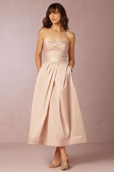 Monique Lhuillier blush bridesmaid dress! A striking alternative to the traditional dress, this bridesmaid separates set is crafted of crisp taffeta in a soft blush hue. Paired with gold heels and crystal chandeliers, your ladies are sure to channel elegance and sophistication. | Salene Taffeta Corset & Skirt from BHLDN Weddings