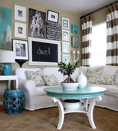 Love the striped curtains! Love the teal! Maybe curarins with brown and teal stripes for my apartment