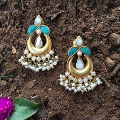 Product Details: Base Material - 92.5 Carat Pure Silver with Gold Plating Technique - Handcrafted Product Type - Temple Jewellery  Design - Dangler Colour - White and Green Length - 4 cm  Width - 2.5 cm  Care Instructions - Avoid Contact with Perfumes and Water Contact No - +91 8095752326 E-Mail - contactus@madhurya.com   Also available in Pure Gold*  Shipping Worldwide