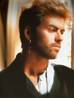 George Michael looks sad :(  Just want to reach out and hug him.