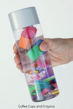 Fun science at home with a sink or float science discovery bottle for kids.