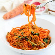 Carrot noodles smothered in a butternut squash sauce with kale and sausage. Unbelievably healthy, delicious and gluten-free!