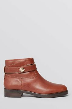 """20 Editor-Approved Pieces Your Closet Needs #refinery29  http://www.refinery29.com/bloomingdales-fall-clothing#slide5  The Flat Bootie """"A brown moto boot pairs just as well with tights and a midi-skirt for work as it does with distressed denim and a pullover for the weekend."""" — BS"""
