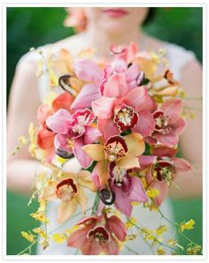 Pretty Cascading Bouquet Comprised Of: Pink & Orange Cymbidium Orchids, Yellow Oncidium Orchids, Fern Shoots••••
