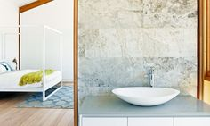 Phoenix loves this bathroom from Grand Designs Australia, with exposed beams, stone tiles and our GORGEOUS Vivid Slimline Oval Vessel Mixer.
